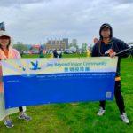 2 Volunteers holding JBVC banner before the 6k run start