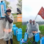 VIP lady with her husband lifting heavy water bottle for World Vision 6k for water event