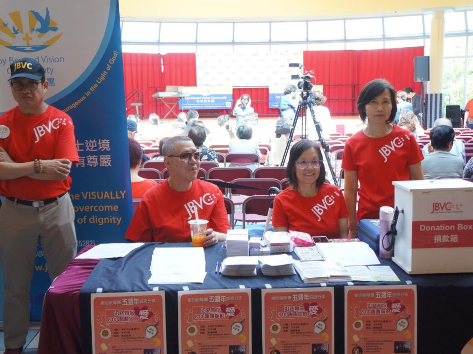 VIPs and non-VIPs serving together at the booth