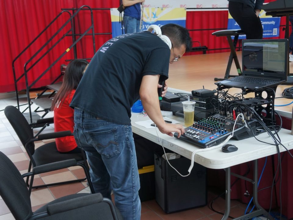 Volunteer busy with audio control behind the scene