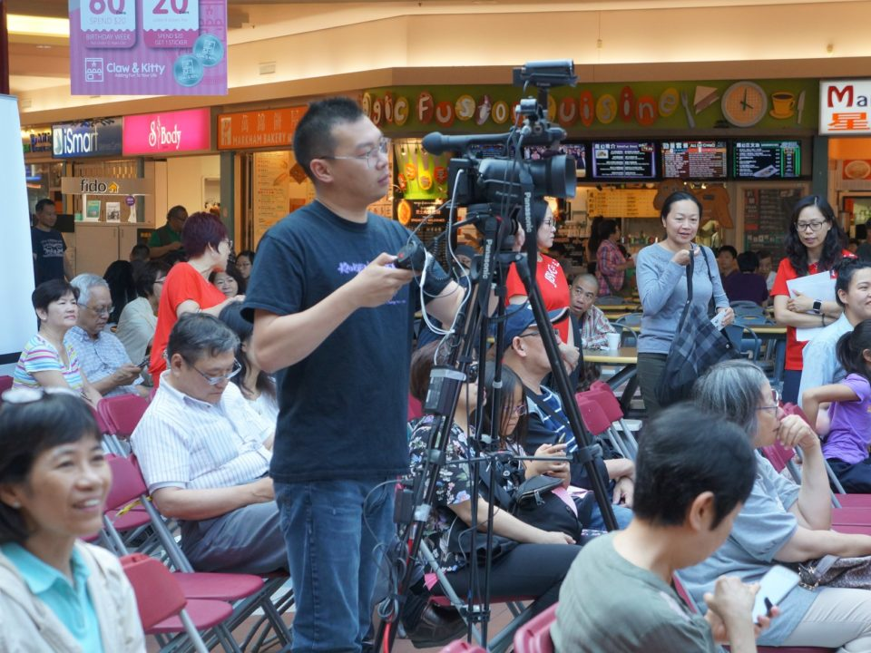 Camera man shooting film of the stage