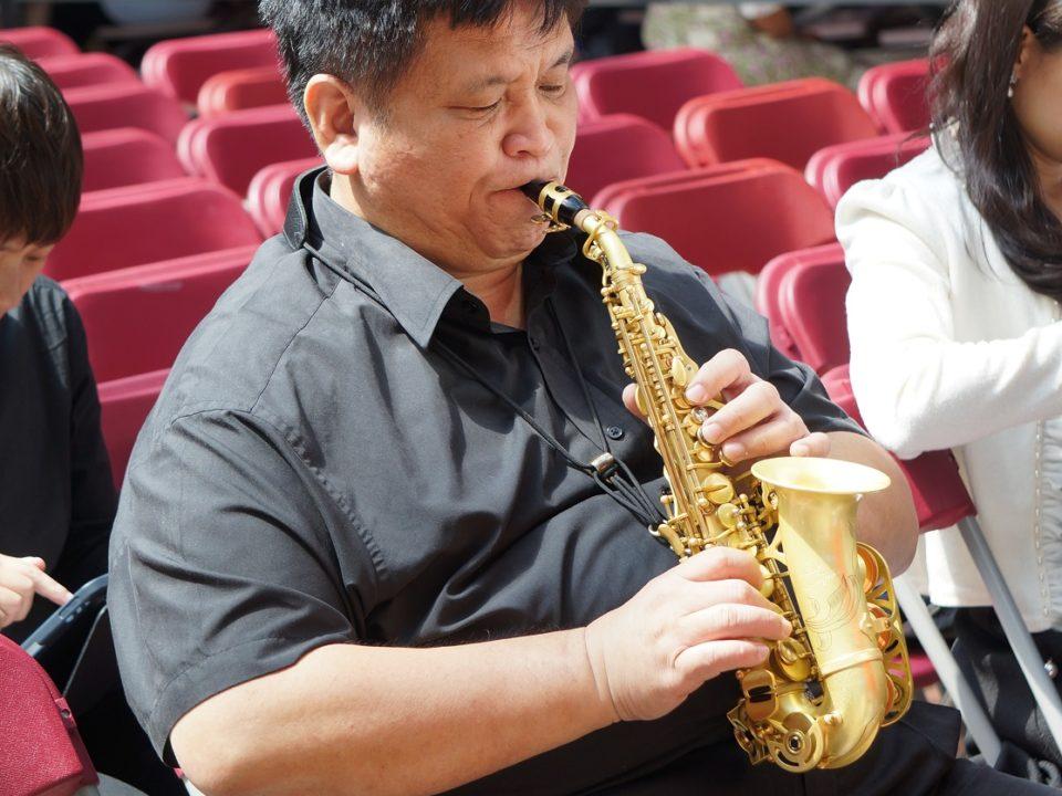 VIP practising saxophone before performance