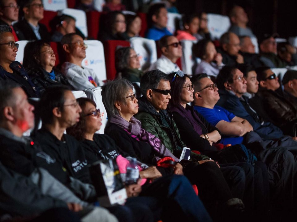 VIPs enjoying movie together with other audiences